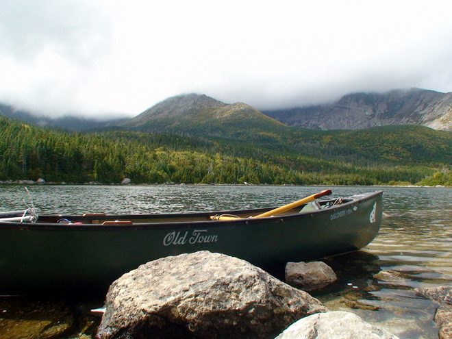 A canoe in Basin Pond halfway up Mt. Katahdin
